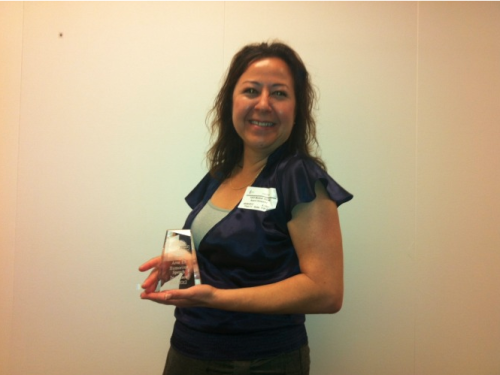 Noemi Gonzalez with a Toastmasters award